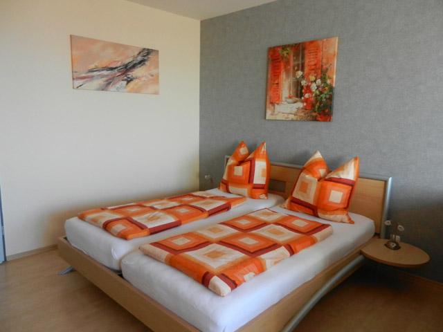 Bett in der Ferienwohnung Grande Seiss am Südstrand von Fehmarn